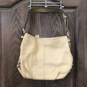 Tan leather Coach purse